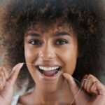 black lady flossing 150x150